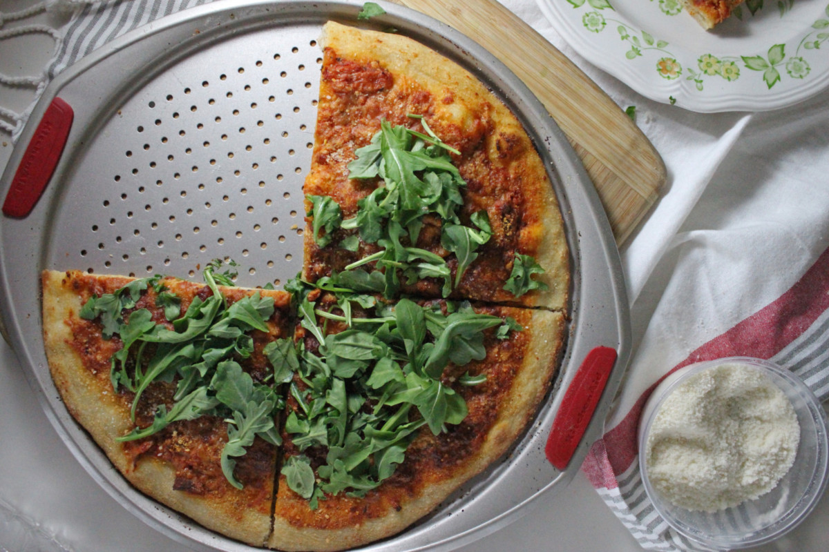 pizza with vodka sauce parmesan and arugula keys to the cucina